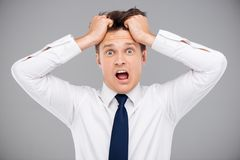 Man tearing his hair Royalty Free Stock Image