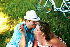 Man teasing woman with strawberry Royalty Free Stock Image