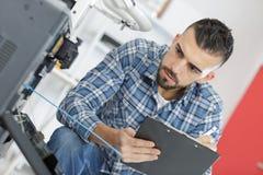Man technician repairing printer at business place at work Stock Photos