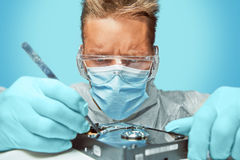 Man technician repairs the drive disk Royalty Free Stock Images