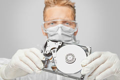 Man technician shows the hard disk Stock Photography