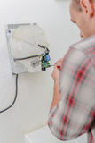 Man or technician trying to fix hand dryer Royalty Free Stock Images