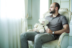 Man with teddy bear Royalty Free Stock Image