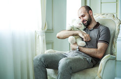 Man with teddy bear. Lovely portrait of a young man with a teddy bear Royalty Free Stock Images