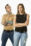 Man and teen female. Caucasian mid-adult man looking at teen female who is looking away Royalty Free Stock Photos