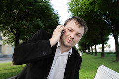 Man with telephone. Outdoor in the sammer Stock Photography