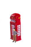 Man and telephone booth Stock Photos