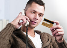 Man, Telephone and Credit Card Stock Images