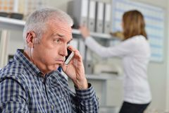 Man on telephone exasperated expression. Man royalty free stock photos