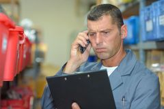Man on telephone looking frustrated stock photos