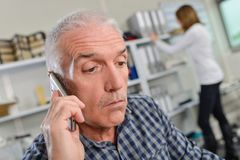 Man on telephone surprised expression royalty free stock photo