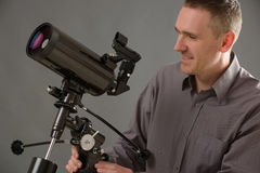 Man with telescope Stock Images