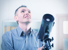 Man with telescope Royalty Free Stock Photo