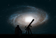 Man with telescope looking at the stars. Bode`s Galaxy, M81. Spiral galaxy in the constellation Ursa Major. Elements of this image are furnished by NASA Royalty Free Stock Photos