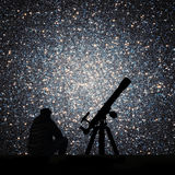 Man with telescope looking at the stars. Globular cluster. Omega Centauri in constellation Centaurus Elements of this image are furnished by NASA stock images