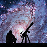 Man with telescope looking at the stars. Messier 83. Southern Pinwheel Galaxy, M83 in the constellation Hydra. Elements of this image are furnished by NASA stock image