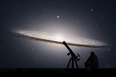 Man with telescope looking at the stars. Sombrero Galaxy M104. In constellation Virgo. Elements of this image are furnished by NASA royalty free stock photography