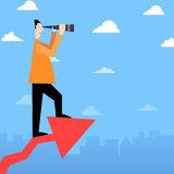 Man with telescope on success arrow Royalty Free Stock Photo