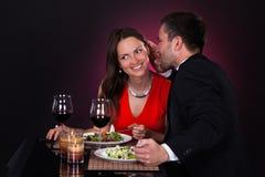 Man telling secret to woman Royalty Free Stock Photos