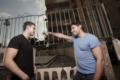 Man Telling The Other Man To Leave Stock Image