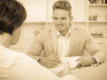 Man tells woman about interesting offers Royalty Free Stock Image