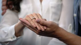 Man tenderly holding fiancee hand with engagement ring, future family, love. Stock footage stock video footage