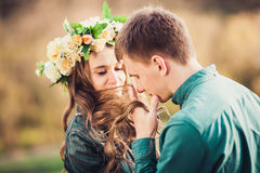 Man tenderly holding and sniffing long hair of caucasian girl Stock Photography