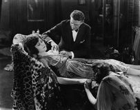 Man tending to injured woman. (All persons depicted are no longer living and no estate exists. Supplier grants that there will be no model release issues Stock Image