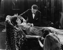 Man tending to injured woman Stock Image