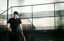 Man on tennis court Stock Images
