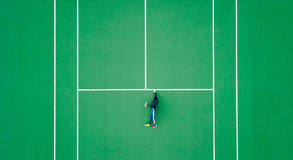 Man on tennis court