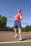 Man on Tennis Court Playing Tennis Stock Photos