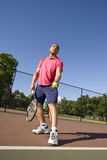 Man on Tennis Court Playing Tennis Stock Photography