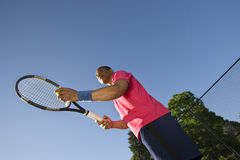 Man on Tennis Court Playing Tennis Royalty Free Stock Photo
