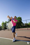Man on Tennis Court Playing Tennis - Vertical Stock Photography