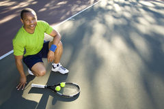 Man on Tennis Court With Racket and Ball Stock Photos