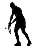 Man tennis player backhand. Man african afro american playing tennis player backhand, on studio isolated on white background Stock Image