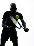 Man tennis player backhand. Man african afro american playing tennis player backhand, on studio isolated on white background Royalty Free Stock Images