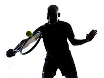 Man tennis player backhand. Man african afro american playing tennis player backhand, on studio isolated on white background Royalty Free Stock Image