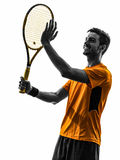 Man tennis player portrait applauding silhouette. One man tennis player portrait applauding in silhouette on white background royalty free stock image