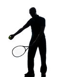 Man tennis player at service. Man african afro american playing tennis player on studio isolated on white background Stock Image