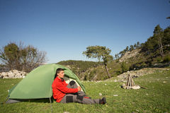 Man with tent camping. Man camping with a tent in the mountains in the summer on a sunny day Stock Photos
