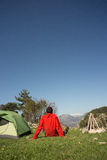 Man with tent camping. Man camping with a tent in the mountains in the summer on a sunny day Royalty Free Stock Photography
