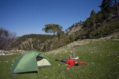 Man with tent camping. Man camping with a tent in the mountains in the summer on a sunny day Royalty Free Stock Photos
