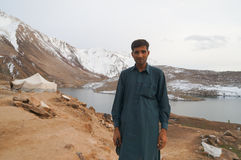 A man and a tent for local people at the lake near Babusar Pass, Royalty Free Stock Photos