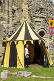 Man in tent. Medieval Display. Warkworth, Northumberland. England. UK. Royalty Free Stock Photo