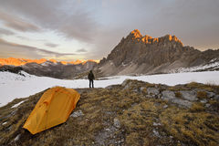 Man with tent observes the Alps Stock Images