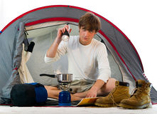 Man in a tent outdoor and cooking Royalty Free Stock Photography