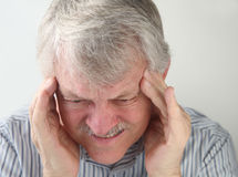 Man with terrible headache Royalty Free Stock Images
