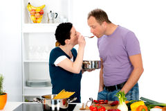Man test the good food of his wife Royalty Free Stock Photo